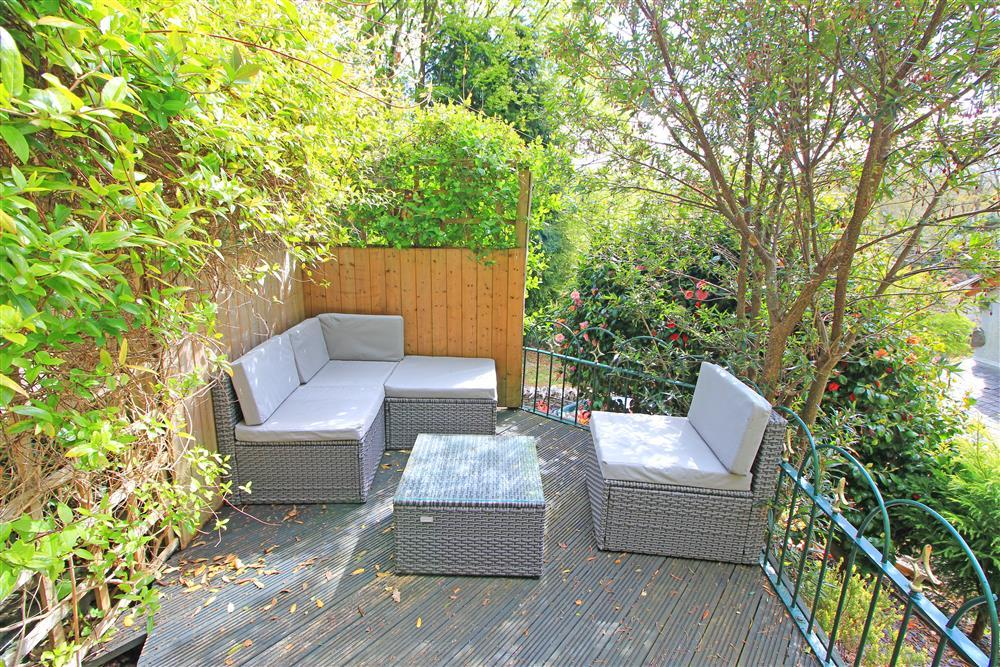 Sitting area in the back garden. The sofa cushions are kept in the garden shed.