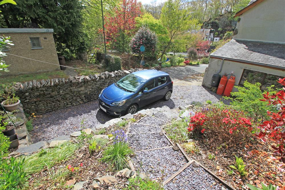 PARKING: For 2 cars. One narrow car park space inside the back garden as shown by this blue car.  Another car park space outside the garage door. There are also parking bays a little further up the road that can be used.
