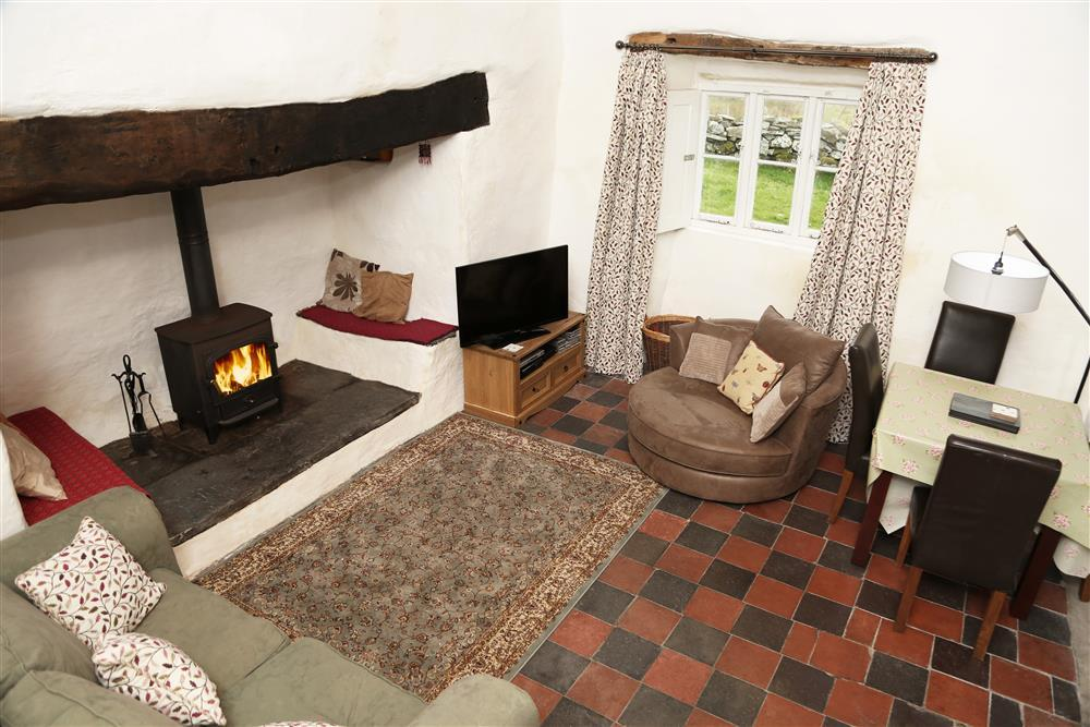 Large lounge and dining area featuring an inglenook fireplace with seating