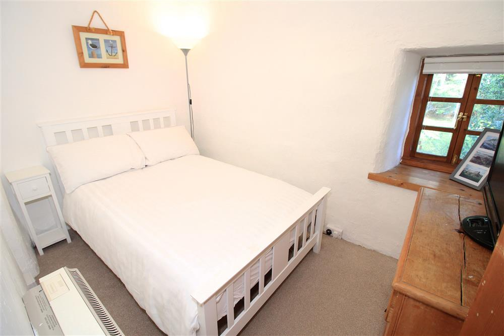 """Bedroom 2 - small double bed: 3'0"""" by 6'3"""" with a small TV (1st Floor)"""