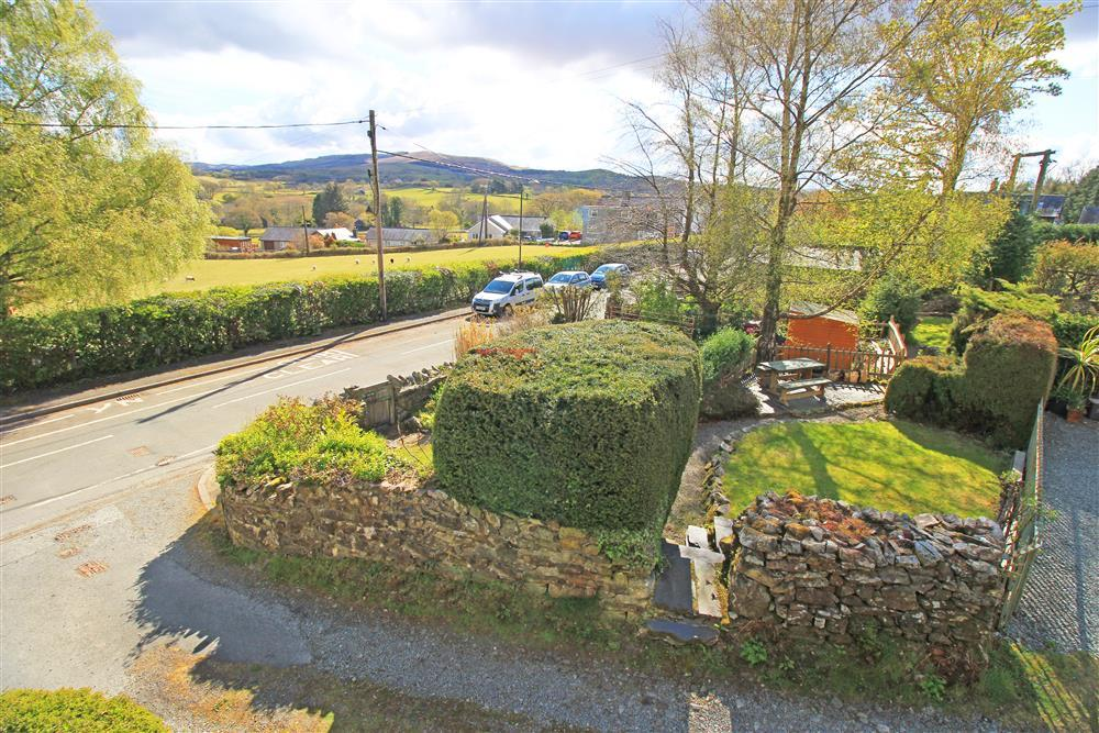 The view fo the front garden and the mountains beyond from Bedroom 1.The little gap in the wall is where you go through to the garden and parking area.