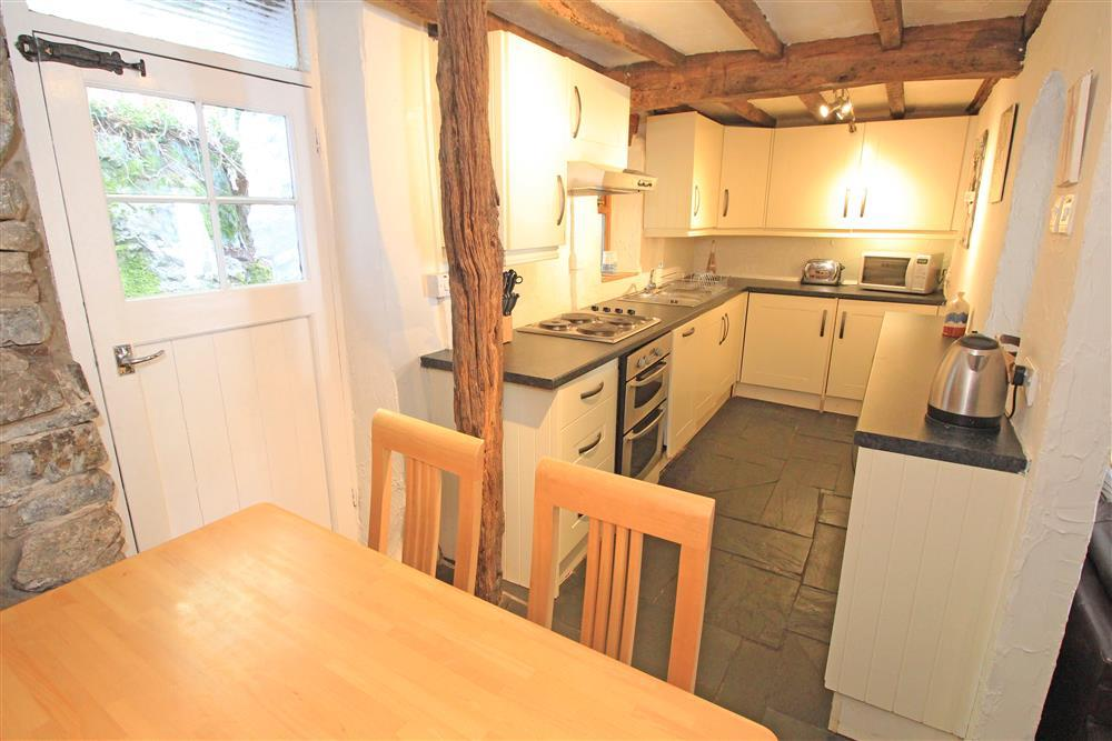 Kitchen, the white door on the left handside of the photo is to the small back garden (Ground Floor)