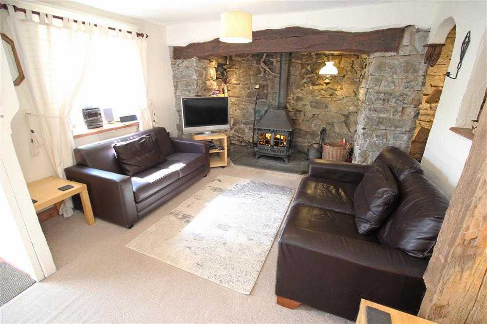 Spacious lounge with feature open fireplace (Ground Floor)