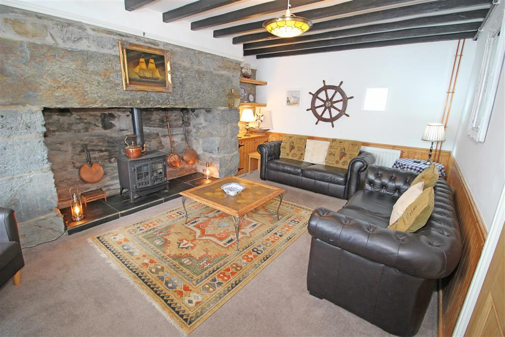 Lounge with feature fireplace only for decoration. (Ground Floor)