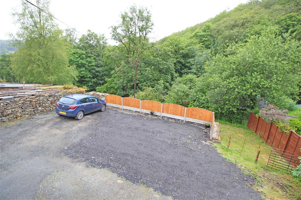 View from bedrooms 1 & 2 of the car park area and the forest above Maentwrog
