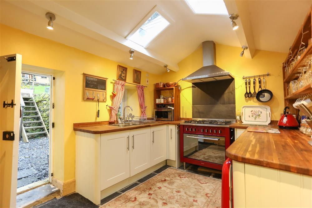 The morden kitchen which has a door to the back garden where the Hot Tub and Games Rooms are
