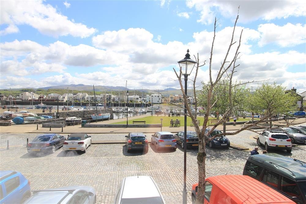 The view over the cobbled street parking area towards Porthmadog Harbour and the Snowdonia mountains beyond. This is the view from Bedroom 1, 2 and 4.