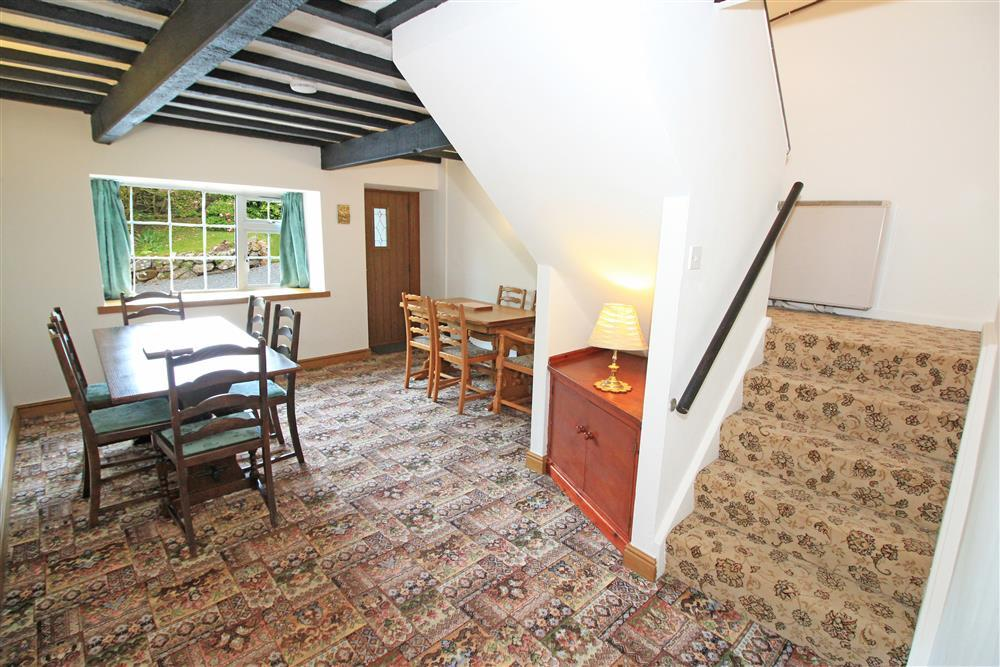 Dining Room, the staircase goes up to Bathroom 2, Bedrooms 5 and 6. (Ground Floor)