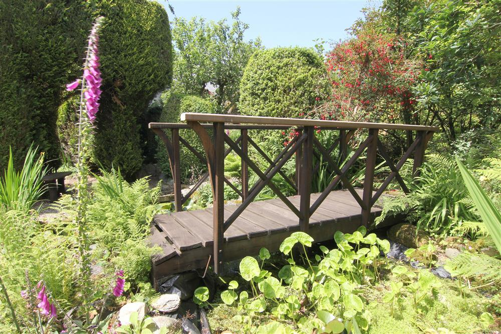 Relax and explore in the beautiful garden. This is the little bridge which goes over a pond next to the hideaway in the back garden.