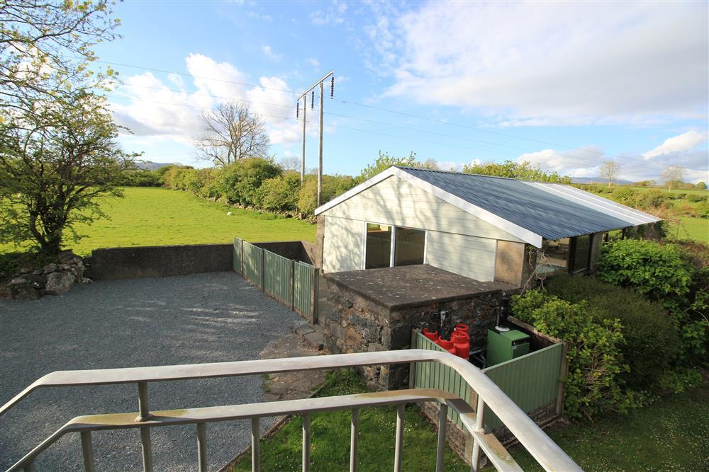 Parking area and the barn where the swimming pool is located (view from top of the external stairs next to Bedroom 6)