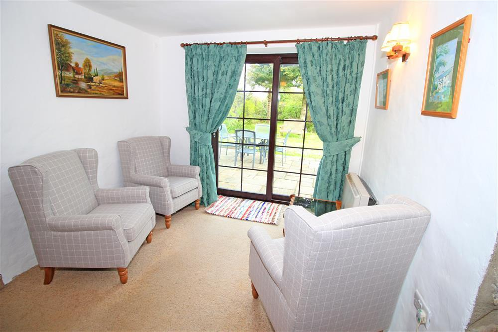 Little snug area in the lounge with patio doors to the back garden.
