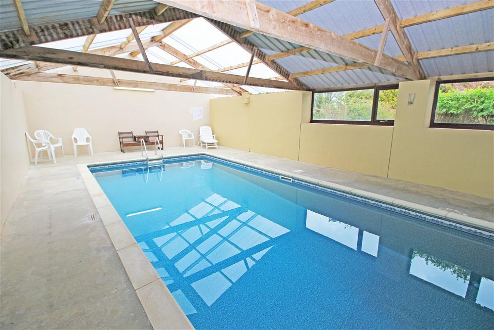 Indoor Swimming Pool which is in a barn next to Tree House.