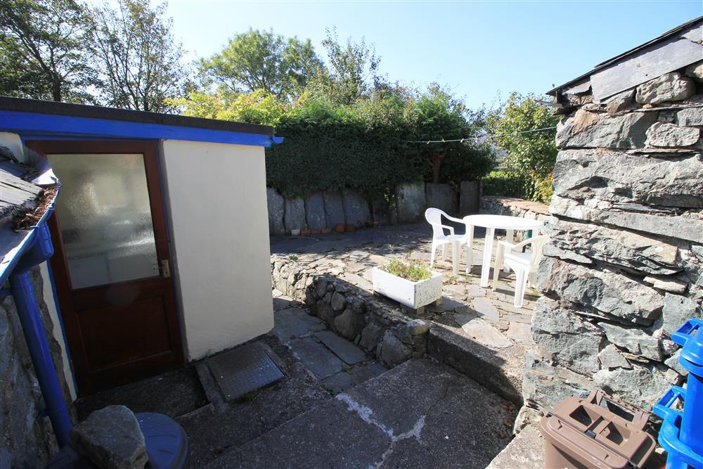 The back patio area, the kitchen door is on the left handside of this photo