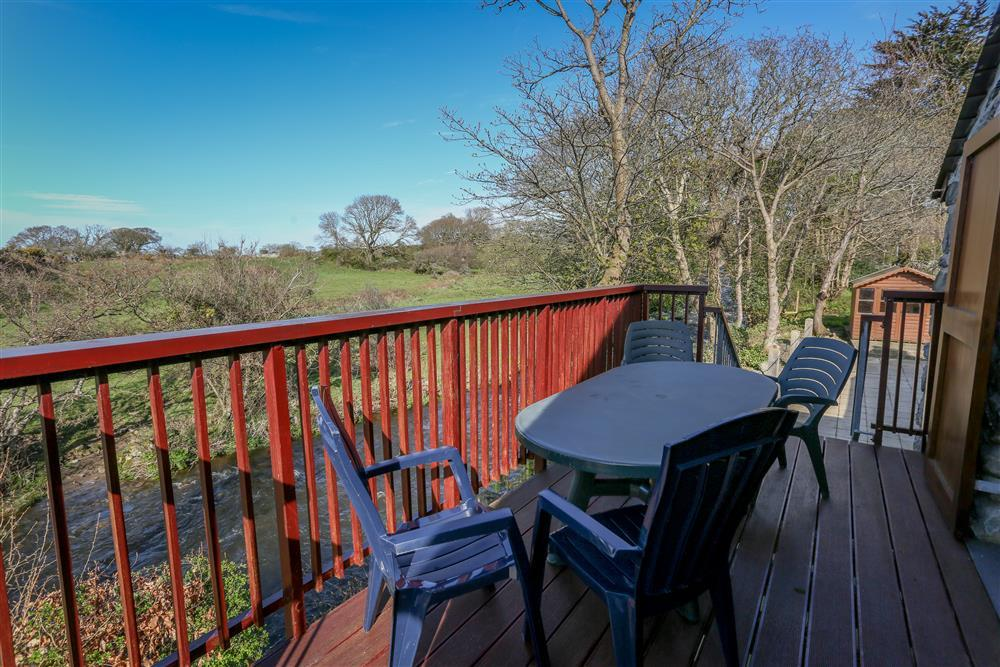 Decking area witih seating, overlooking the river