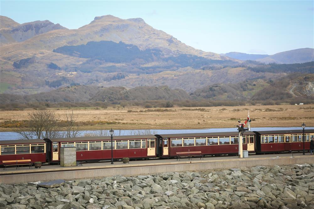 A close up photo from the balcony of steam train carriages at Porthmadog Train Station - The Cob