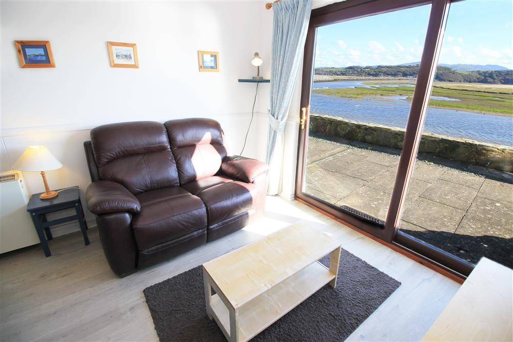 Living Room - Lounge area with patio doors opening on to patio area with views of the estuary.