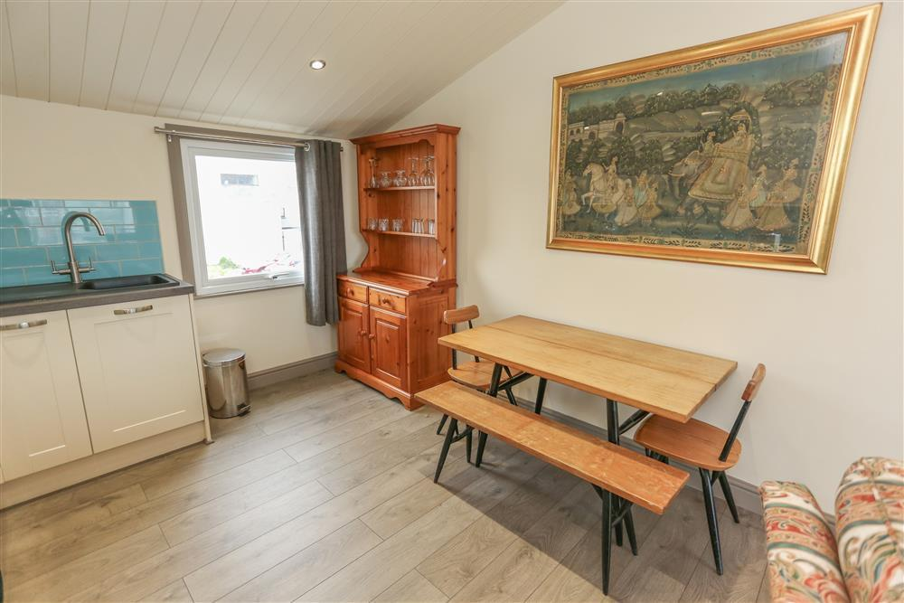 Dining table and chairs in Kitchen area (1st Floor)