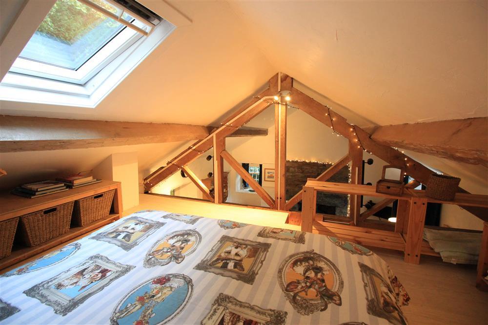 Bedroom 3:  Double futon in the crog loft with low ceiling above the Living Room. From this bedroom you can see the fairy lights around the beams and the fireplace in the Living Room