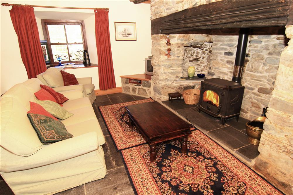The lounge features a stunning feature Inglenook fireplace
