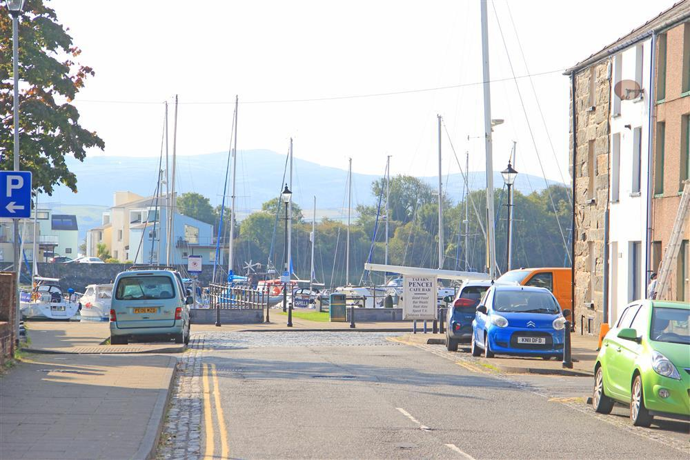 Close up photo of Porthmadog Harbour from the road. The harbour  is 110 yards down this road, 2 minute walk away.