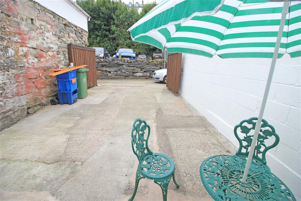 Photo of the enclosed back patio, there is free street parking at the front of the cottage or you can pay £5.50 for 24 hours parking at the Car Park near the back of the cottage.