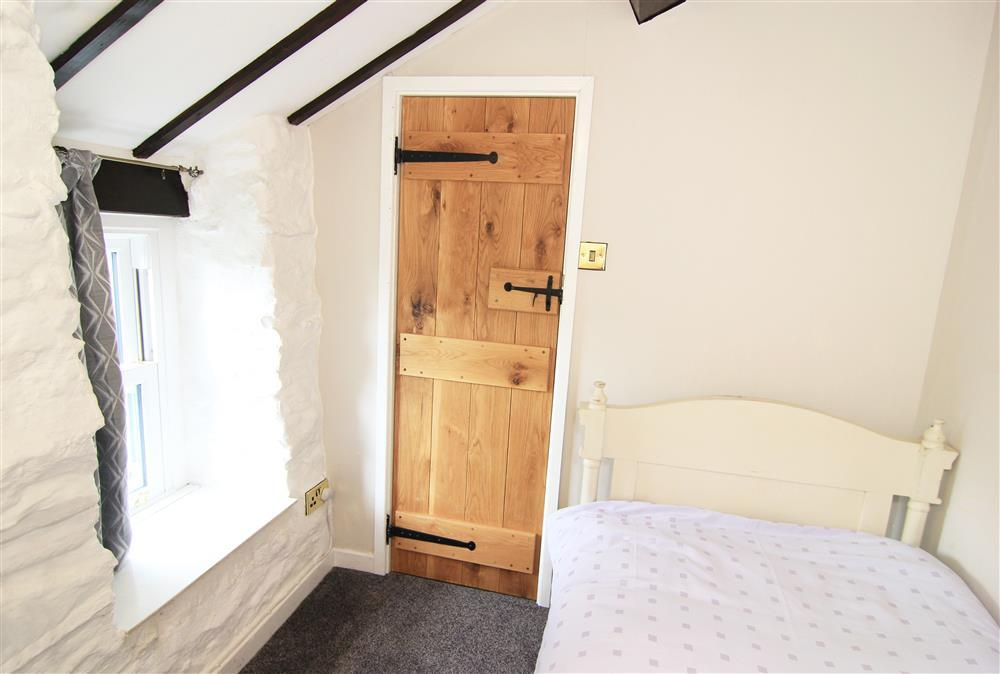 Bedroom 3: Single bedroom with a window with mountain views