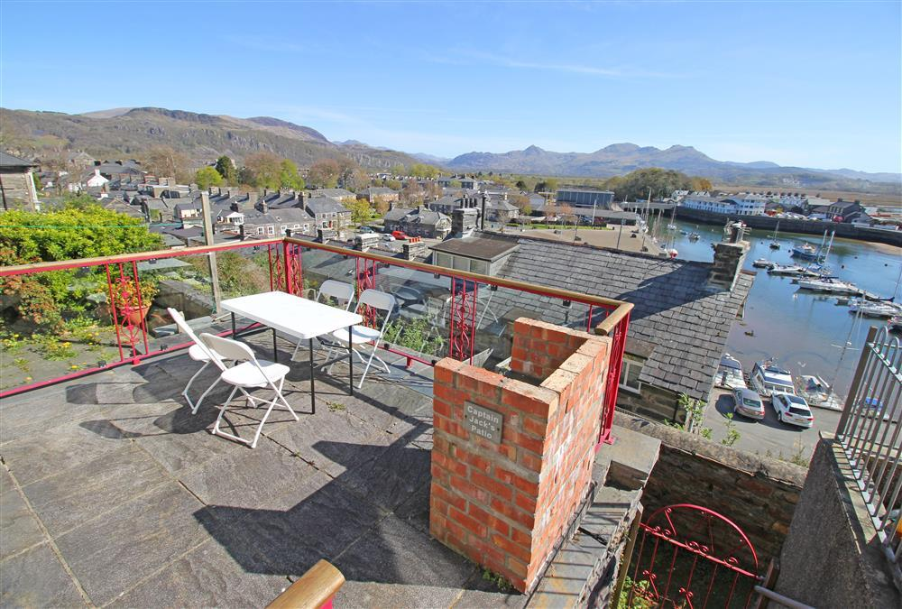 Patio area with views of Porthmadog Harbour and the Snowdonia mountains beyond