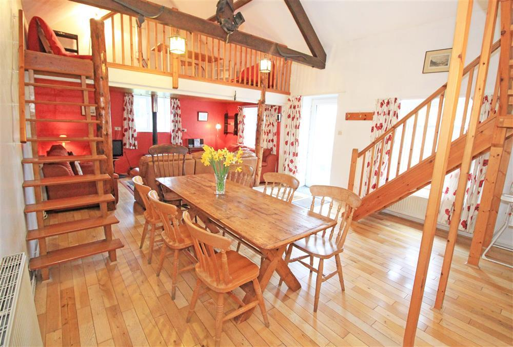 Living Room - Dining area with a staircase up to the crog loft above the lounge area (ground floor).
