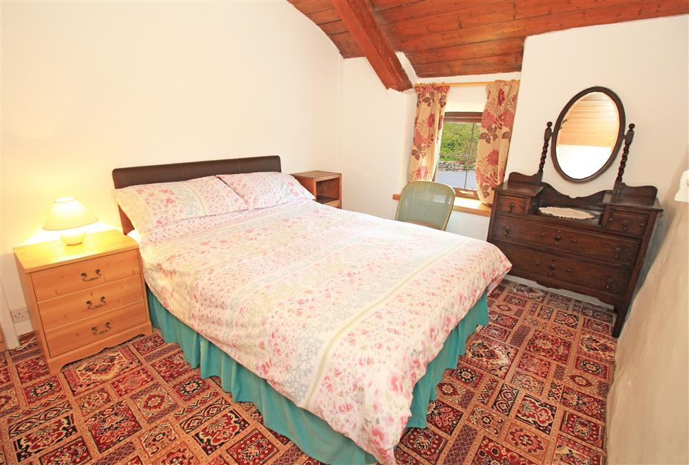 Bedroom 2: 1 double bed with a window looking out to the driveway at the front of the farmhouse (1st Floor in the farmhouse)