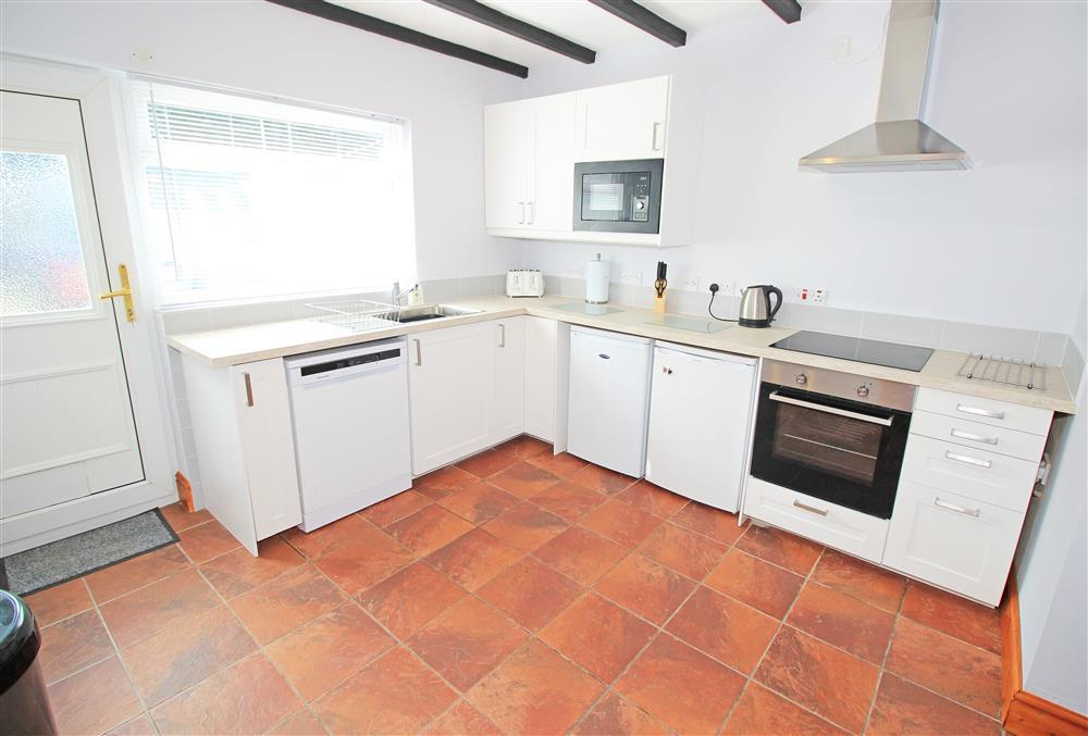 Kitchen with a door to the back patio area (Ground Floor)