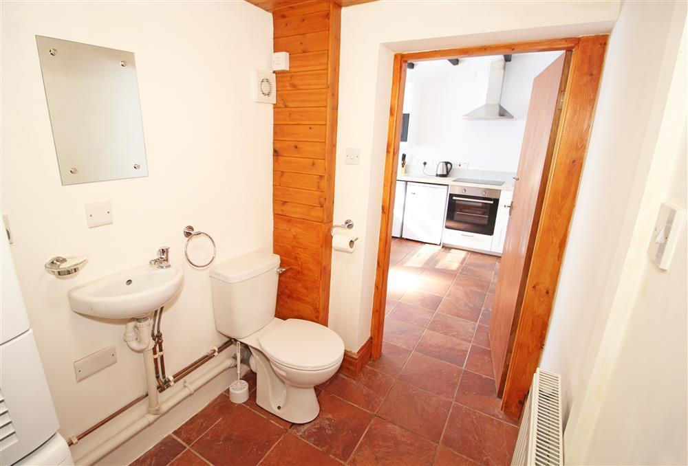 WC/ UTILITY ROOM: Off the kitchen with washing machine and Tumble Dryer (Ground Floor)