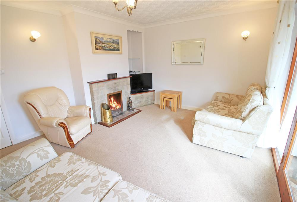 Lounge on the ground floor - same level as bedrooms 2, 3, 4, bathroom & shower room. Open Fire is available at an extra charge of £30, please inform us when booking.