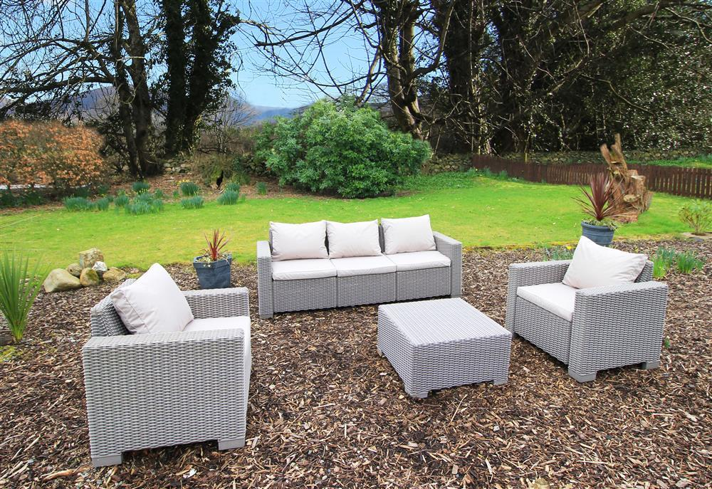 Sitting area in the shared garden of Zig Zag and Dowlias Cottages.