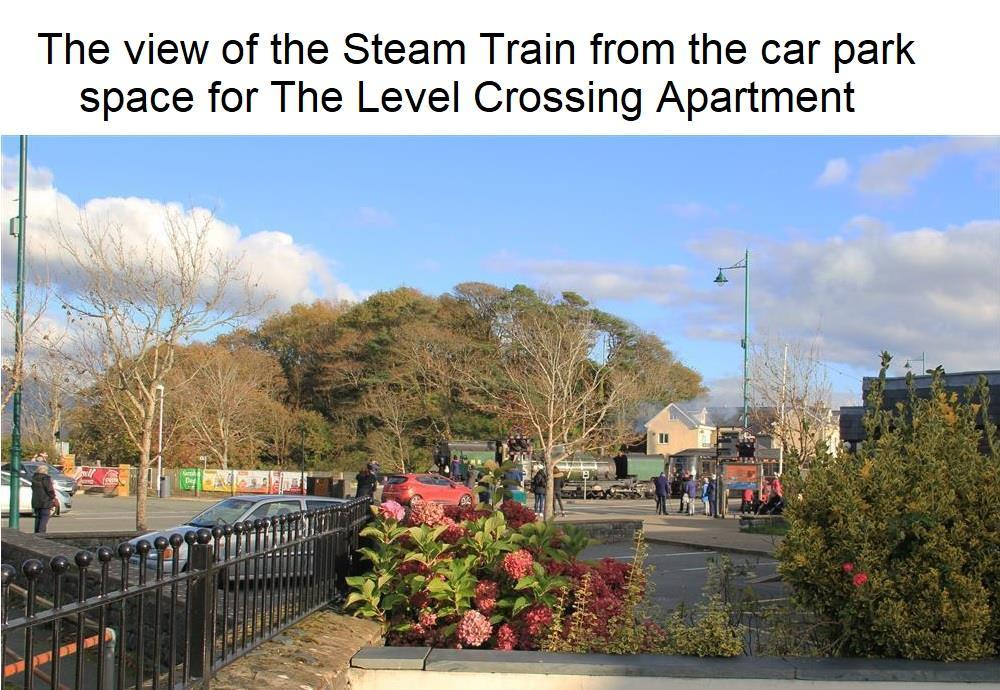 Photo taken from Car Park Space for Level Crossing apartment.The Level Crossing apartment is next to where the Steam Train crosses the road. This trainline from Porthmadog goes towards Beddgelert and ends at Caernarfon.