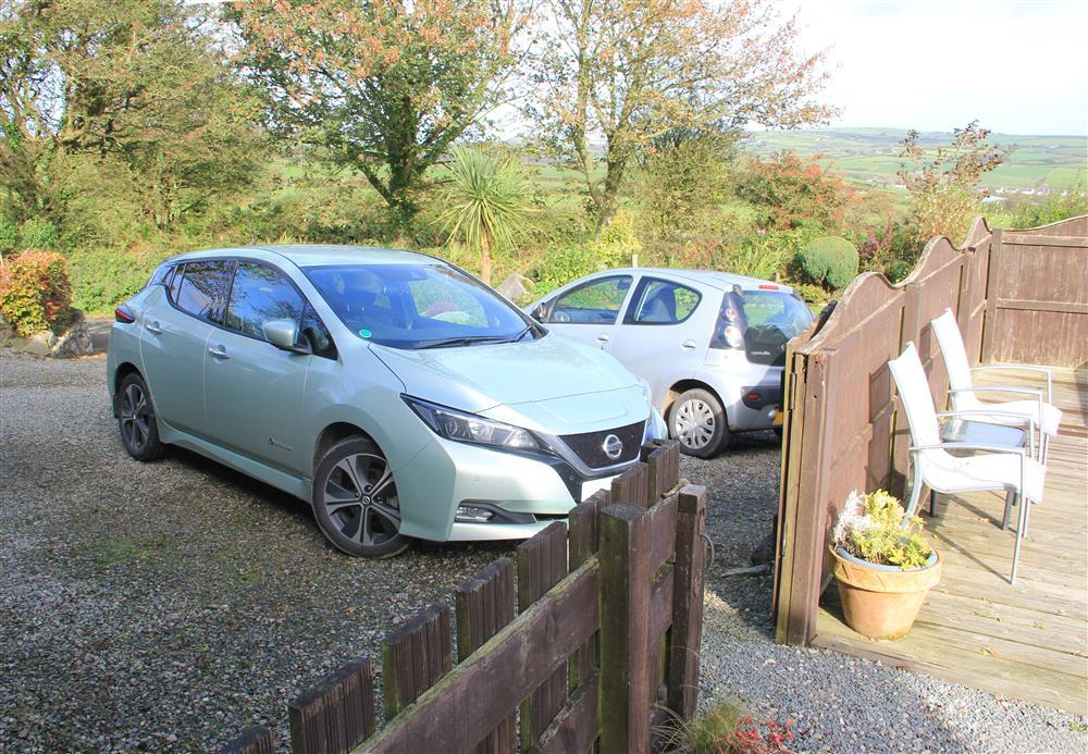 The car park area and the gate into Moonlight Cottage garden