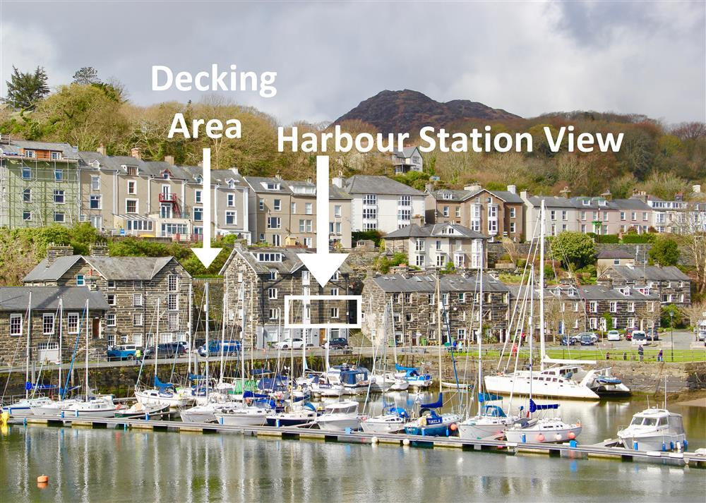 The view of the apartment and the sharded decking area with views over the harbour, steam trains and mountains.