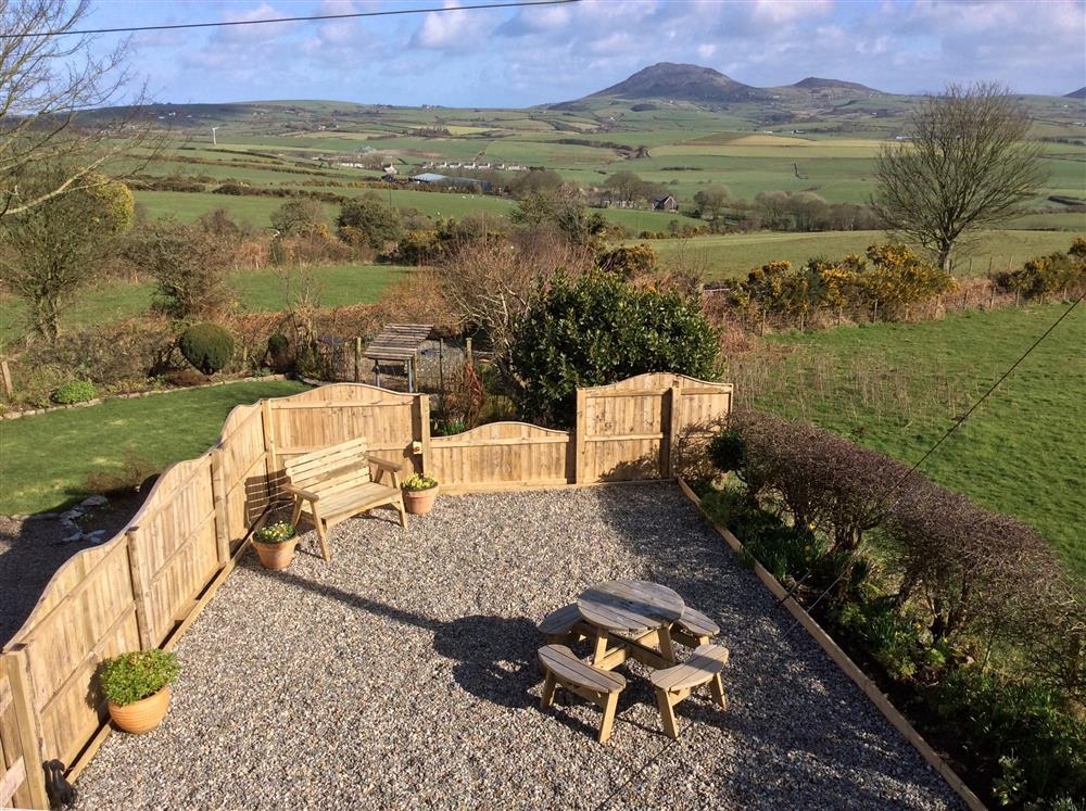 The view from Kingsize bedroom of the garden. You can see Garn Fadryn and other mountains in Snowdonia in the distance.