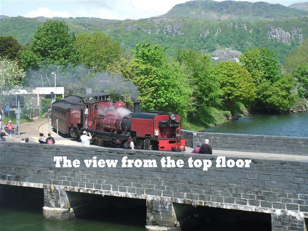 The steam train going on to the bridge towards Porthmadog Habour station. This view can be seen from Living room and Bedroom 1 & 2.
