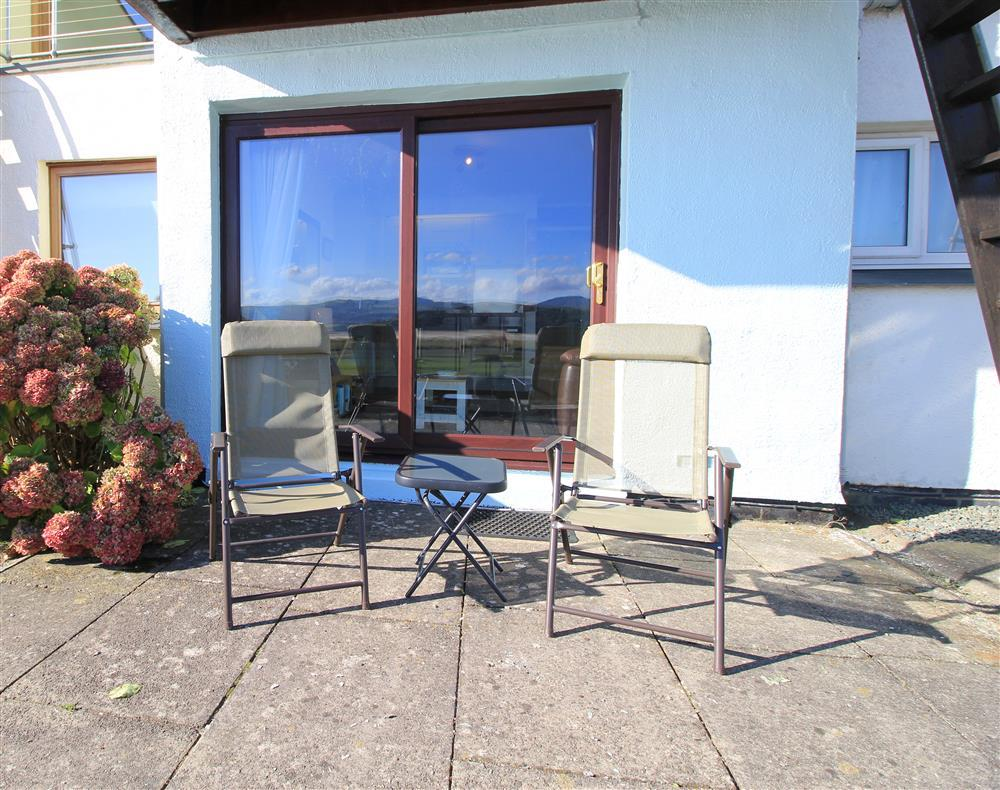 Exterior view of flat. The deck chairs and little table are kept insde the apartment.