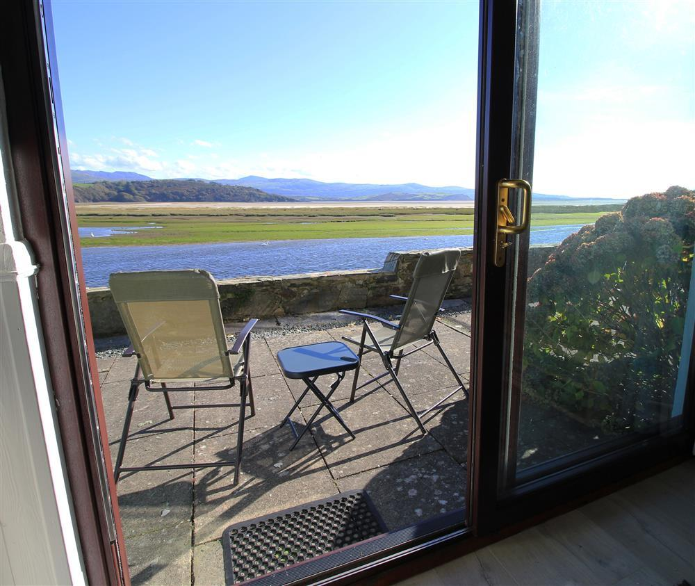 Patio Area with estuary views. The deck chairs and little table are kept insde the apartment