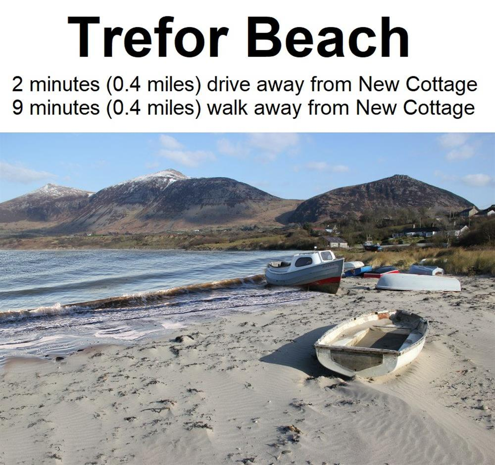 New Cottage is 9 minutes walk (0.4 mile) away from Trefor Sandy Beach. Photo of High Tide at Trefor Beach.