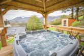 The HOT TUB is in a stunning wooden gazebo with views over the mountains and valley of Ffestiniog