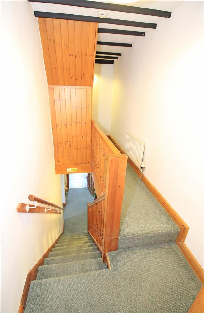 photo taken from the doorway of the bathroom looking down at the staircase.