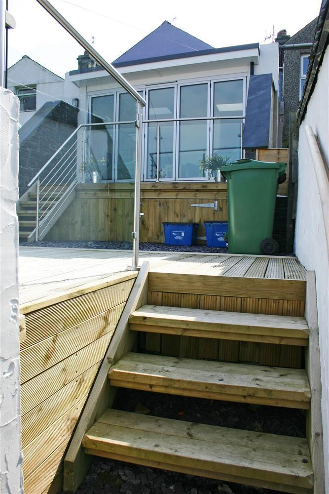 Steps in the decking area to back garden gate