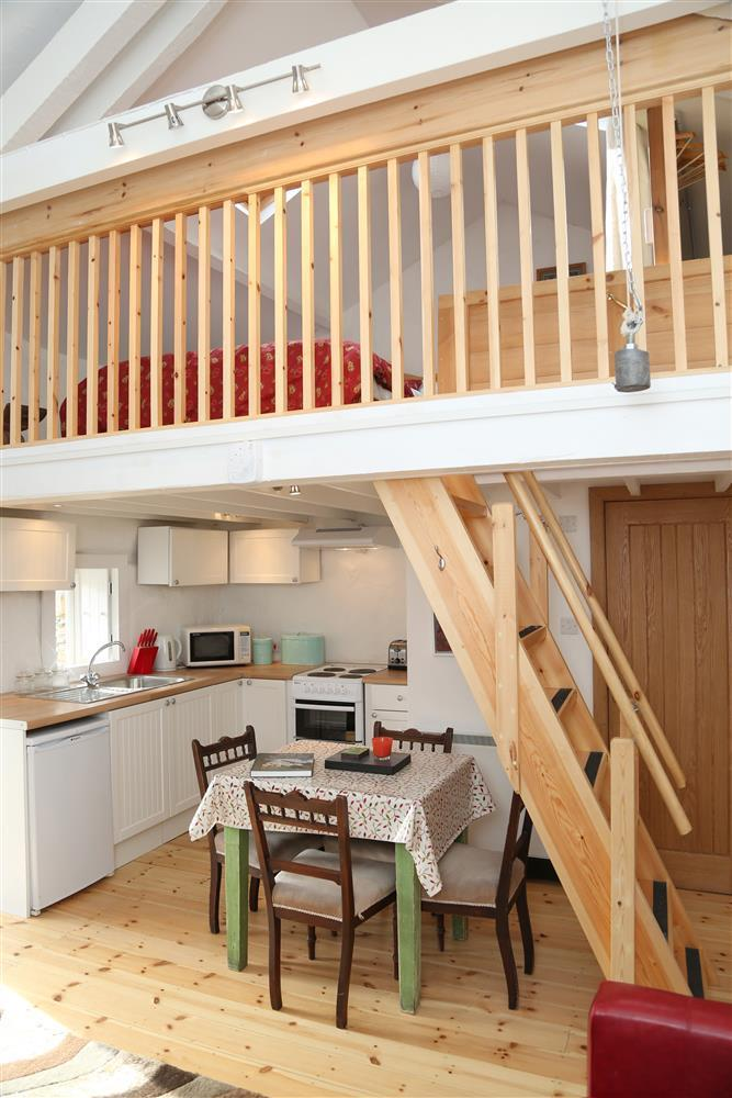 The bedroom is up in a crog loft in the open plan annexe (access is up a steep ship's ladder)