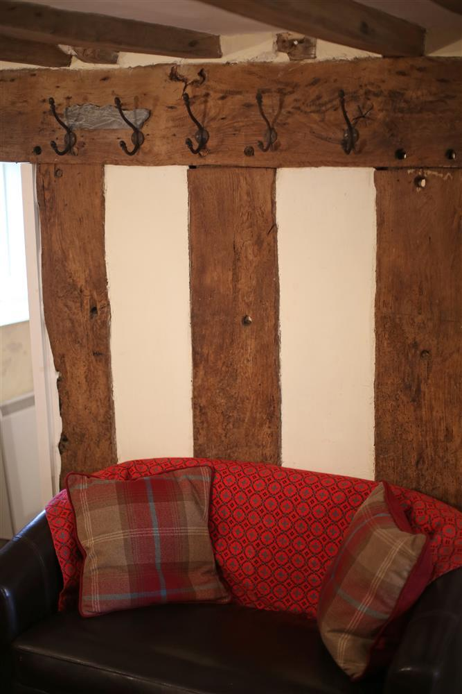 The old farmhouse still has its original beams exposed
