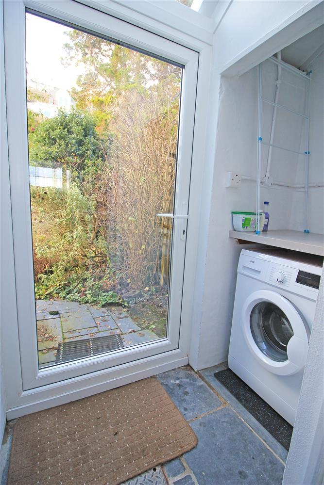 Utility Room with a washing machine and the door to the Back Garden (Ground Floor)