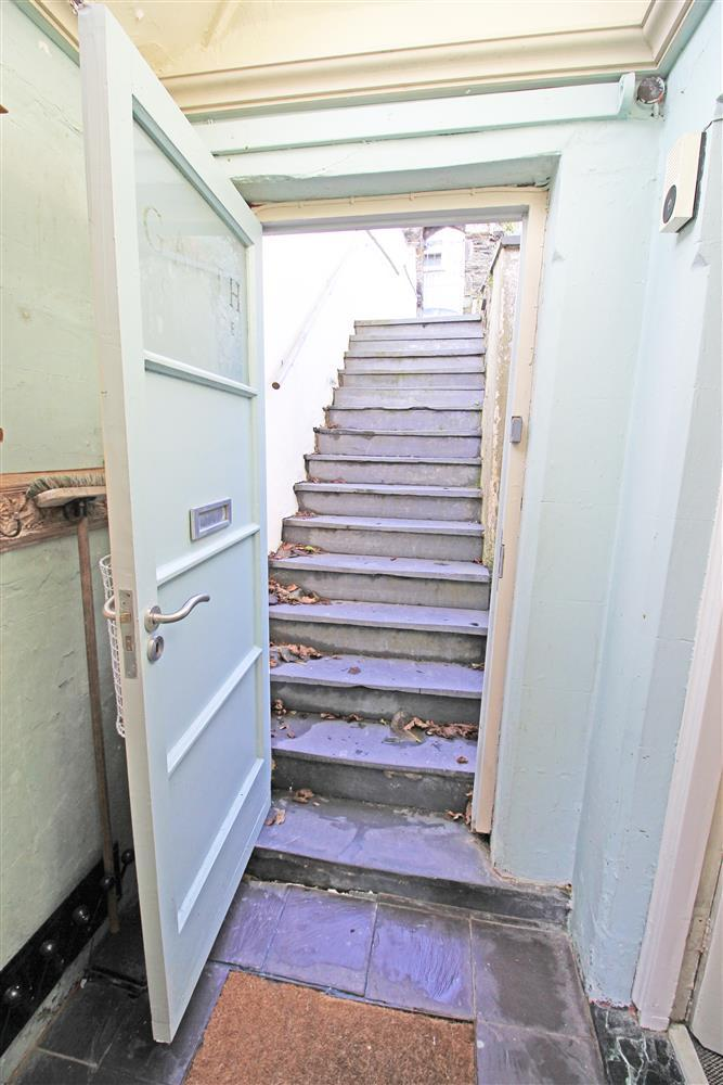 Front door of Garth Cottage and looking up at the external staircase