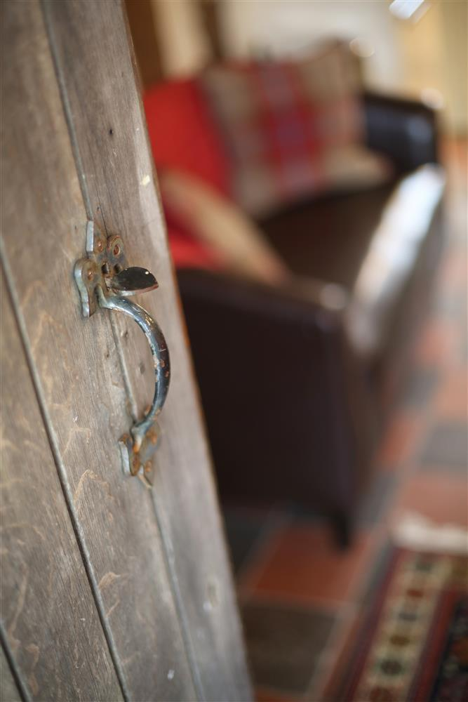 Cae Canol has an old wooden door for an authentic farmhouse feel