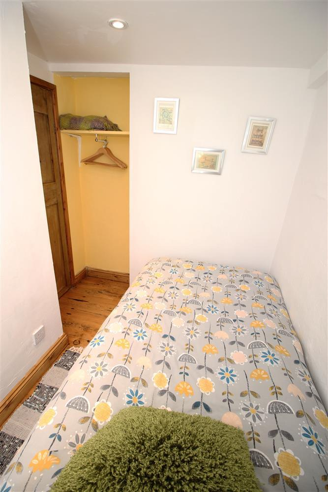 Bedroom 2: Single bedroom with hanging space